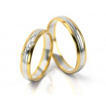 Wytworne dwukolorowe obrączki ślubne z trzema cyrkoniami