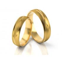 Obrączki ślubne z żółtego złota zdobione fantazyjnym grawerem