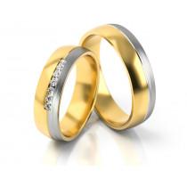 Obrączki ślubne z żółtego złota ozdobione białym paskiem