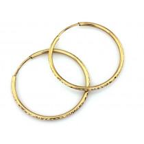 Złote kolczyki koła z diamentowaniem