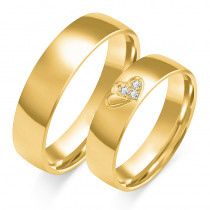Złote obrączki ślubne z sercem i diamentami
