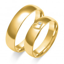Złote obrączki ślubne z sercem i diamentem