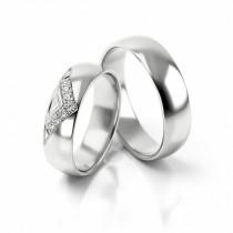 Ekskluzywne obrączki ślubne z białego złota z eleganckim zdobieniem w postaci cyrkonii