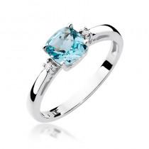 Elegancki pierścionek zaręczynowy z białego złota przyozdobiony diamentami i topazem