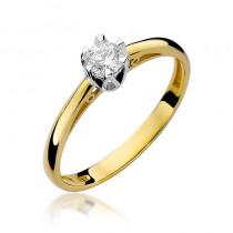 Lśniący zloty pierścionek zaręczynowy z okazałym diamentem