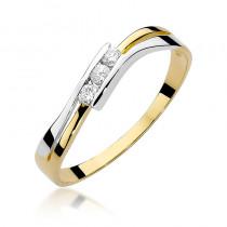Subtelny złoty pierścionek ozdobiony lśniącymi brylantami