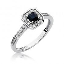 Stylowy złoty pierścionek zaręczynowy ozdobiony szafirem i diamentami