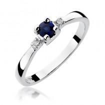 Elegancki złoty pierścionek zaręczynowy wysadzany szafirem i diamentami