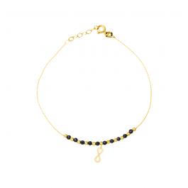 Złota bransoletka ze znakiem nieskończoności i czarnymi kulkami z oksydowanego złota