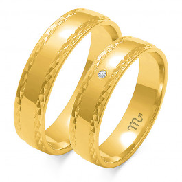 Złote żółte obrączki ślubne z efektownie zdobionymi brzegami
