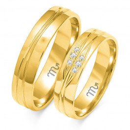 Wytworne obrączki ślubne z białego złota ze stylowym zdobieniem