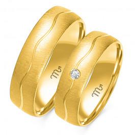 Oryginalne złote obrączki ślubne z eleganckim zdobieniem