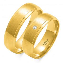 Obrączki ślubne z żółtego złota ozdobione brylantem