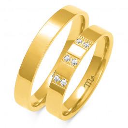 Żółte, złote obrączki ślubne z kamieniami