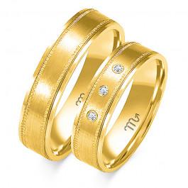 Złote obrączki ślubne wytwornie zdobione