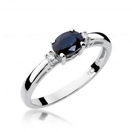 Wyszukany pierścionek z białego złota ozdobiony szafirem i diamentami