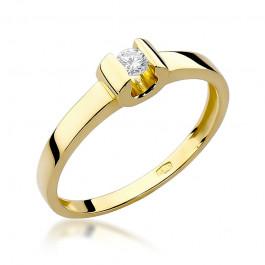 Wyszukany złoty pierścionek zaręczynowy ozdobiony diamentem