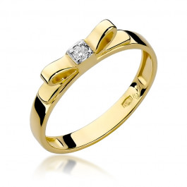 Niezwykły złoty pierścionek z kokardką ozdobiony brylantem