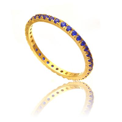 Złoty pierścionek z niebieskimi cyrkoniami