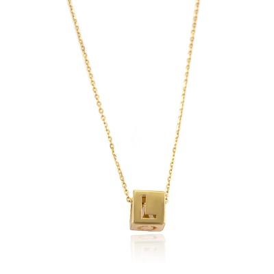 Niepowtarzalny złoty naszyjnik z ozdobnym elementem i napisem LOVE