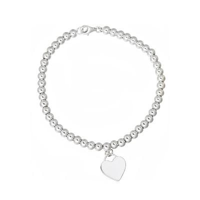 Elegancka srebrna bransoletka z sercem