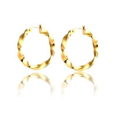 Złote kolczyki ozdobne koła