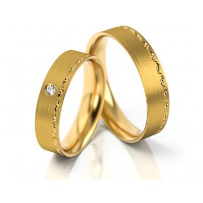 Obrączki ślubne z żółtego złota z ozdobnym grawerem