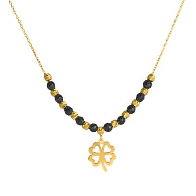 Złoty naszyjnik z koniczynką i czarnymi kulkami z oksydowanego złota