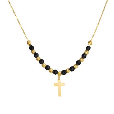 Złoty naszyjnik z krzyżykiem i czarnymi kulkami ze złota