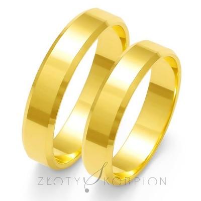 Tradycyjne obrączki ślubne z ozdobnymi ścięciami po bokach