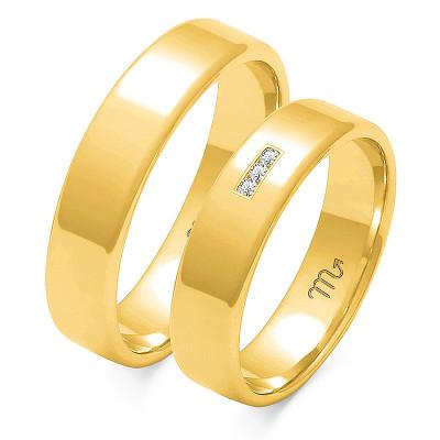 Klasyczne, delikatnie zdobione obrączki ślubne z żółtego złota