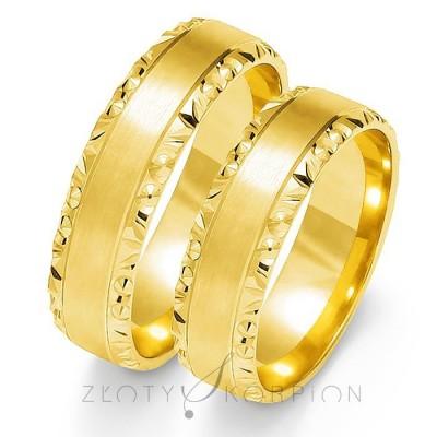 Wytworne złote obrączki ślubne z efektownymi brzegami