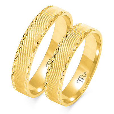 Wytworne złote obrączki ślubne pięknie zdobione