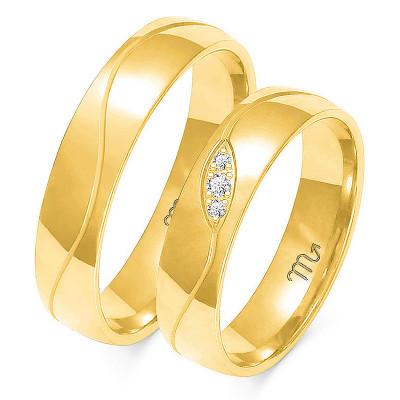Obrączki ślubne z białego złota z nacięciem w kształcie fali
