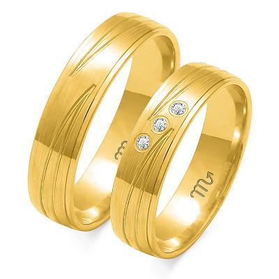 Eleganckie złote obrączki ślubne z pomysłowym nacięciem