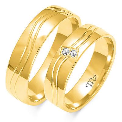 Obrączki ślubne z białego złota z ozdobną falą i kamieniami