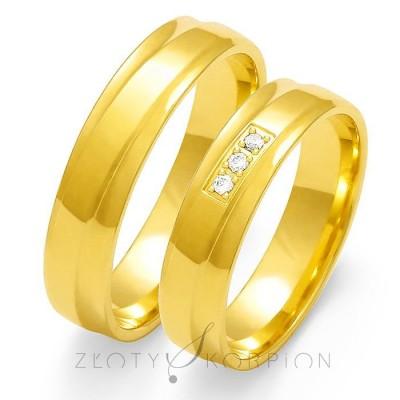 Żółte złote obrączki ślubne delikatnie zdobione