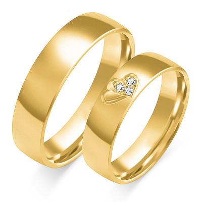 Złote obrączki ślubne z sercem i cyrkoniami