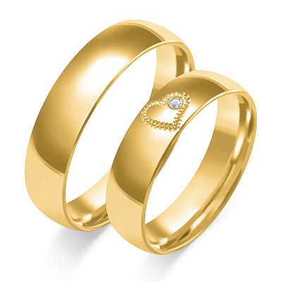 Złote obrączki ślubne z sercem i cyrkonią