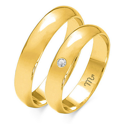 Klasyczne półokrągłe obrączki ślubne z brylantem