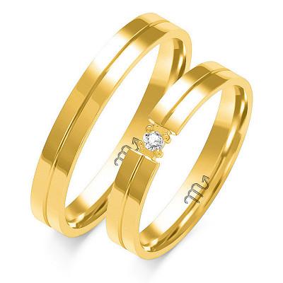 Obrączki ślubne z białego złota z gustownym nacięciem i kamieniem