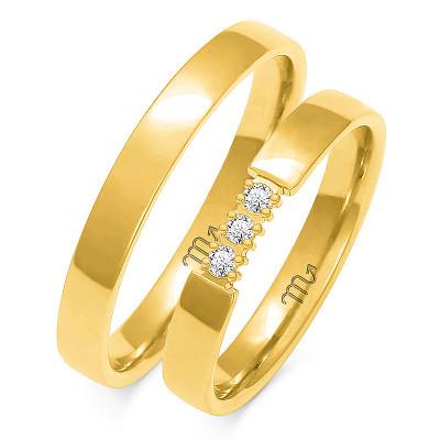 Szykowne półokrągłe złote obrączki ślubne z kamieniami