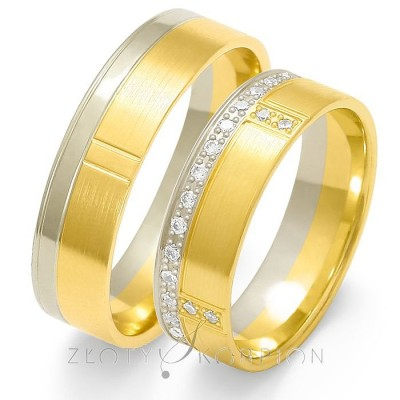 Szykowne złote obrączki ślubne z efektownym zdobieniem