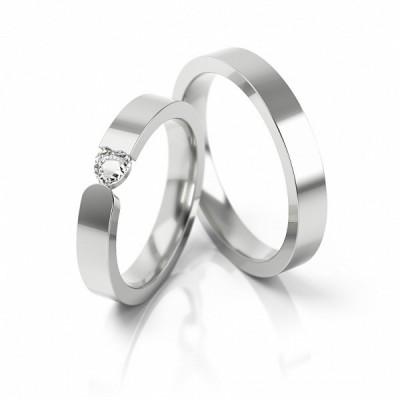 Obrączki ślubne z białego złota z kamieniem w kształcie serduszka