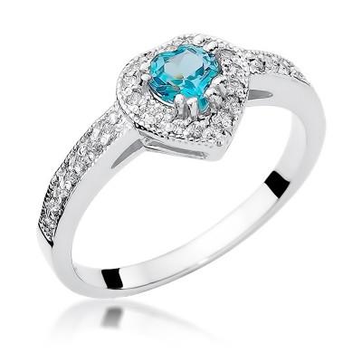 Nietuzinkowy pierścionek z białego złota ozdobiony topazem w kształcie serca i diamentami