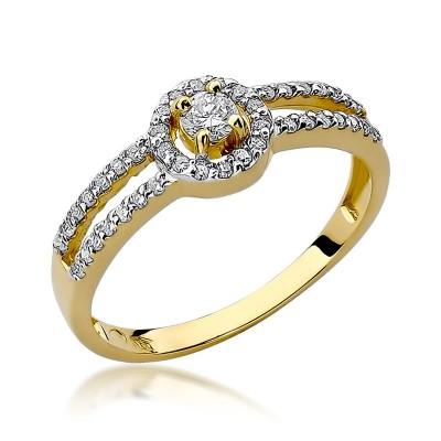 Okazały złoty pierścionek zaręczynowy ozdobiony diamentami