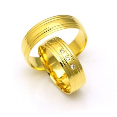 Obrączki ślubne z żółtego złota z ozdobnymi nacięciami