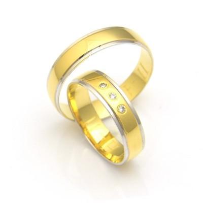 Obrączki ślubne  z żółtego złota z delikatnym zdobieniem krawędzi