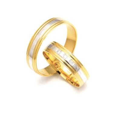 Obrączki ślubne złote ozdobione białym paskiem
