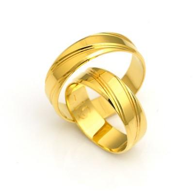 Obrączki ślubne z żółtego złota z delikatnym intrygującym żłobieniem
